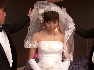 A Japanese bride wears her wedding gown while bouncing on a dick