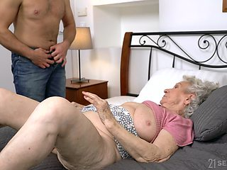Dirty granny Norma B spreads her legs for her younger lover
