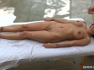 hot brunette is getting a massage