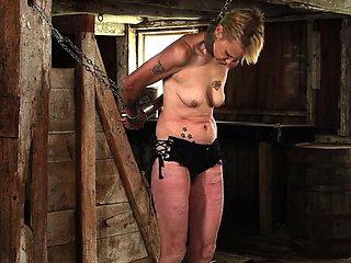 mature slave in flogging.
