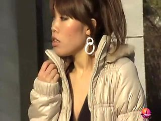 Gorgeous vocal Asian brunette loses her outfit during fast sharking scene