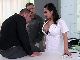 Busty brunette doctor Tigerr Benson fucked by two large dicks