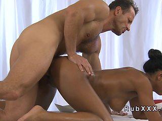 Tanned hottie got hard masseurs cock