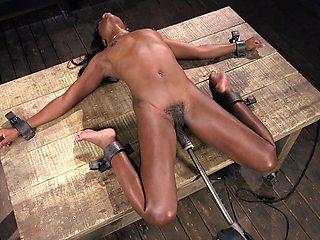 Mature sibmissive ebony slut Ana Foxxx has her hairy pussy abused