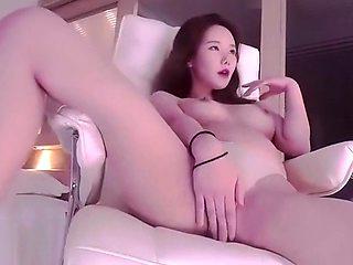 Korean BJ Neat in bikini shows her boobs