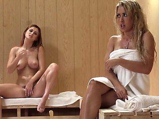 Busty redhead lezdom facesitting in the sauna