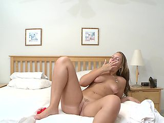 A sexy bitch undresses herself and plays with her cunt on the bed