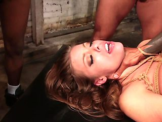 After getting her tied up, they proceed with gruesome fucking
