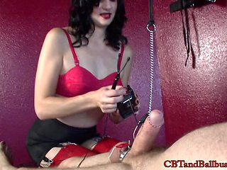 Couples enjoying a hot steamy femdom and ball busting BDSM shoot