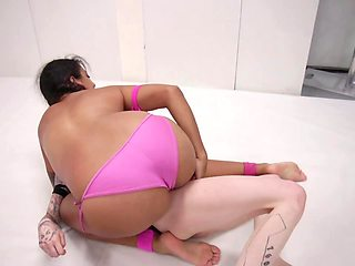 Tanned girl takes strapon and starts shoving it inside opponent