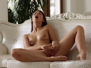 Brunette is full of passion to masturbate with dildo