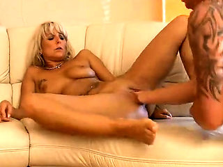 Kinky blonde milf with big boobs takes a fist in her pussy