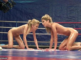 Slippery nude female wrestling with oiled up Ioana and Babette
