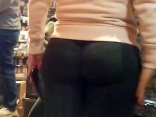 Candid perfect ass in leggings bending over close up