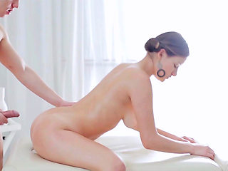 Some natural tits are getting oiled up along with an ass