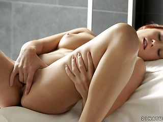 Redhead spreads her legs to fuck herself, take vibrator in her eager wet spot
