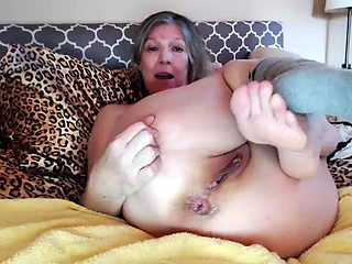 Busty amateur granny with pigtails masturbates on the webcam