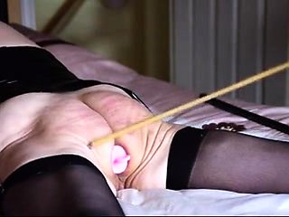 Luscious mature wife in stockings gets punished on the bed