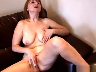 Busty old woman rubs her mature clit