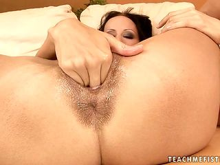 Dangerously seductive babe with giant melons opens her legs to fuck herself with sex toy