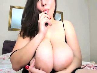 European milf enjoys putting big dildo inside tight pussy