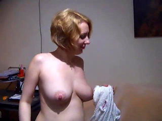 A milf stripping down