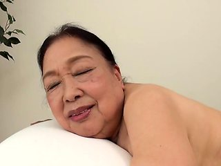 Horny Asian granny has a young masseur satisfying her needs