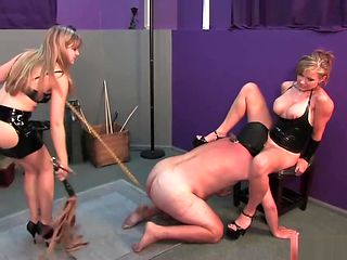 Two Femdom Mistresses destroy balls during tongue service