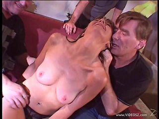 Long haired babe takes cumshot after fucked in a close up gangbang