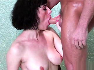Hot mature busty masseuse with hairy pussy gives nice handjob and suck dick in the shower