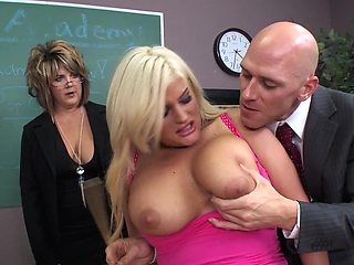 A plump blonde is getting fucked on the desk in the school