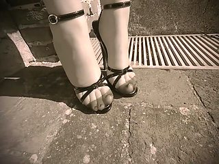 Walking on the ancient stone in domina sandals and nylon stockings