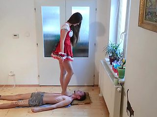 Creative Goddess Bubli places her sexy feet on her male slaves neck