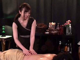 Sensual massage ends with an oiled girl being penetrated nicely