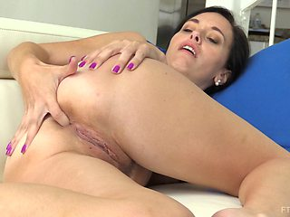 Home alone brunette Savannah puts a buttplug in her tight ass