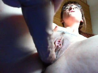 Young little sister opens her pussy in a videochat for money