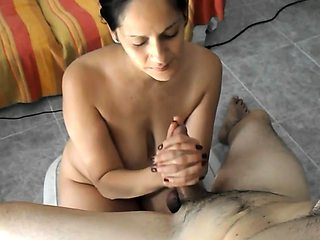 Stacked brunette wife milks a dick with her skillful hands