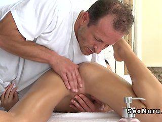 Slim brunette gets erotic foot massage