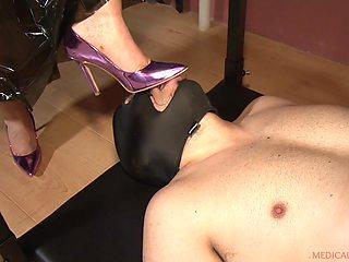Patricia MedicalySado steps on her slaves balls with her heels