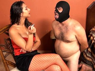 Mistress Jenn Capone using her ashtray and spittoon slave