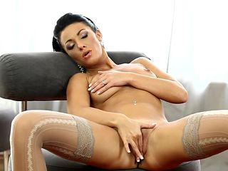 Brunette does striptease before playing with her cunt