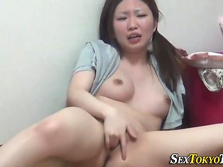 Asian Buzzing Her Clit With Vibrator