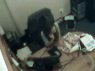 Brunette dildo fucks pussy in the office chair in hidden cam vid
