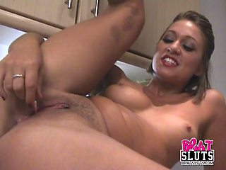 Randy slut in the kitchen fingering her pussy in homemade video