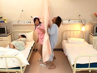 Busty Japanese nurse in pink makes two patients cum