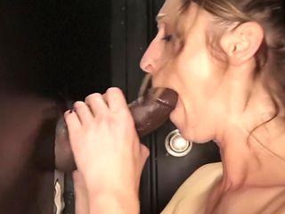 Mature slut sucks 2 BBCs and swallows their cum at the Gloryhole