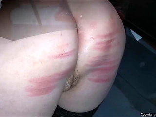 Rubber hooded slut gets a taste of discipline