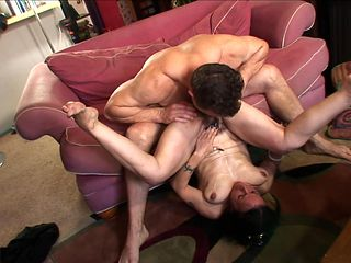 Brunette shows her slutty side to hard dicked guy by taking his erect schlong in her mouth