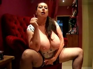 huge-breasted slut Mommy smoking and masturbates
