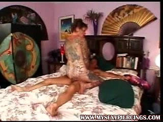 Heavy tattooed and pierced granny fucked doggy style